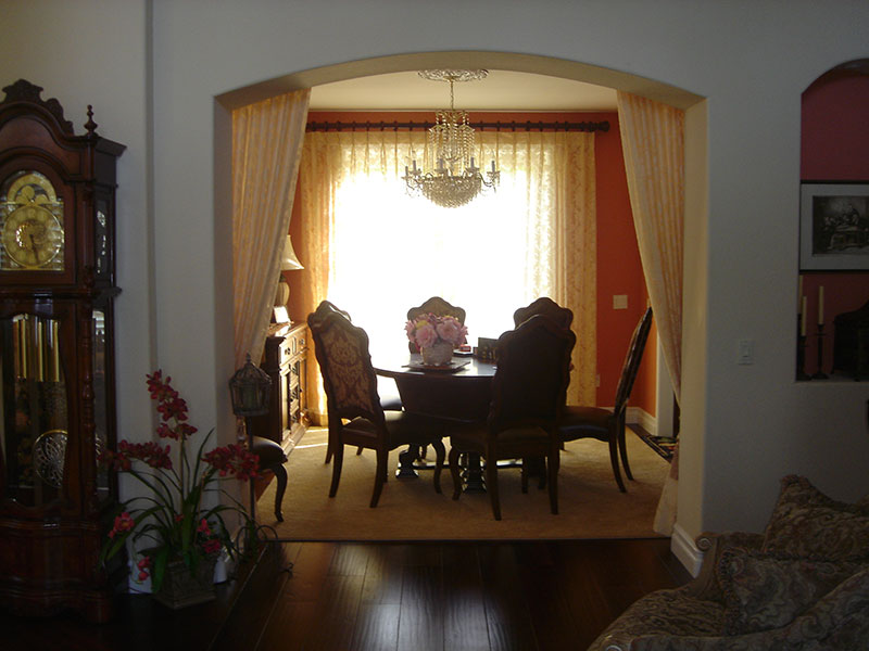 Fabric softens the archway in the formal dining room in Corona, CA