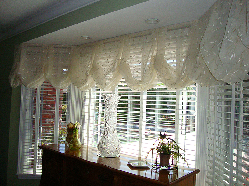 Elegant curtains and blinds frame a marvelous view