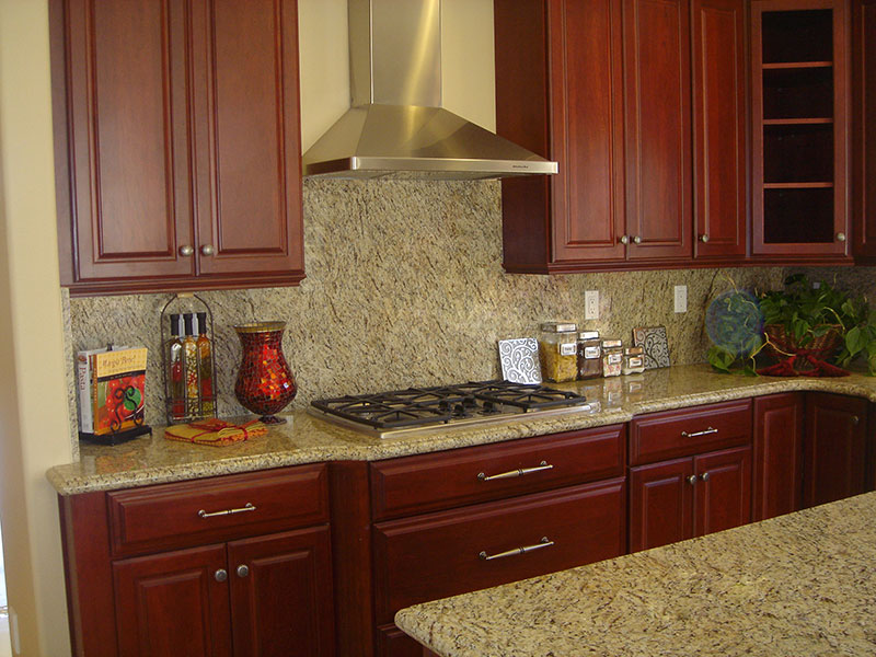 Cherry cabinettes and granite countertops enhance this warm inviting kitchen